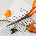 marriage certificate being torn apart