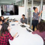 Team members of a PR agency in Melbourne having a meeting