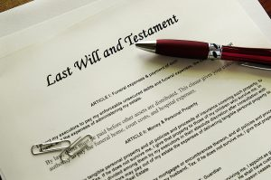 Last Will and Testament document and a pen
