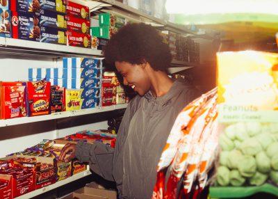 Woman inside a British sweet shop