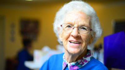 Old woman inquiring about the best aged care advice