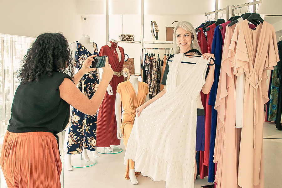 Two woman checking out dress shops in Townsville