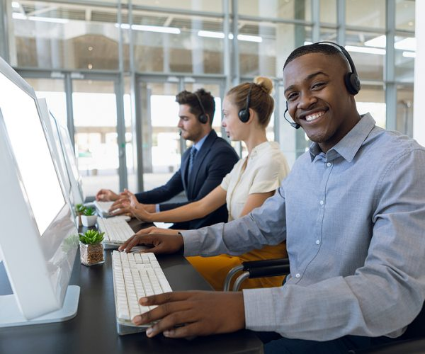 African man smiling inside the office wearing the best workwear in Australia online store