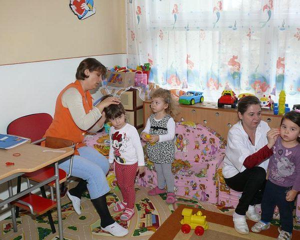 Childcare punchbowl teacher taking care of the children
