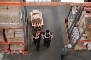 3pl workers transferring boxes